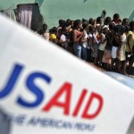 People queue to receive items at a USaid