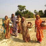 Women carrying water from unimproved source in Bangladesh credit water.org