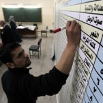 An election official tallies votes in Amman, Jordan