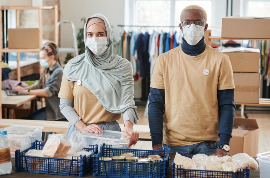 adults volunteering in food banks