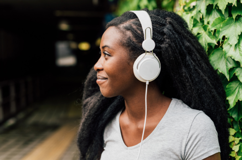 young person happy with headphones